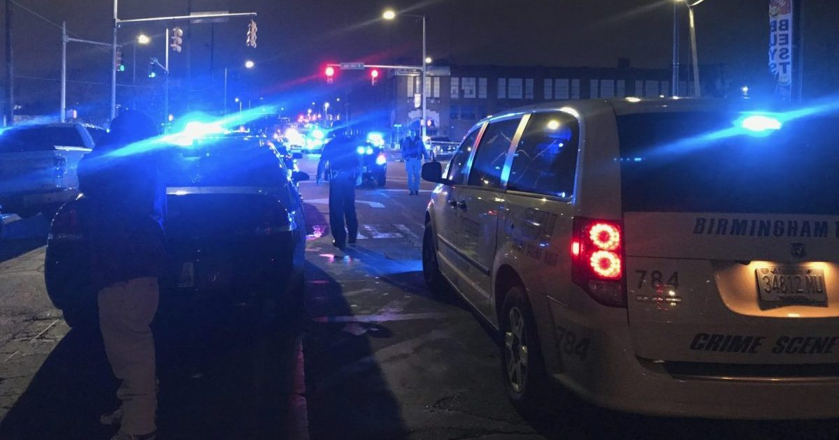 Law enforcement personnel work the scene early Jan. 13, 2019, after a police officer was killed and another critically wounded in a shooting as the officers questioned two people suspected of trying to break into cars, in Birmingham, Alabama.