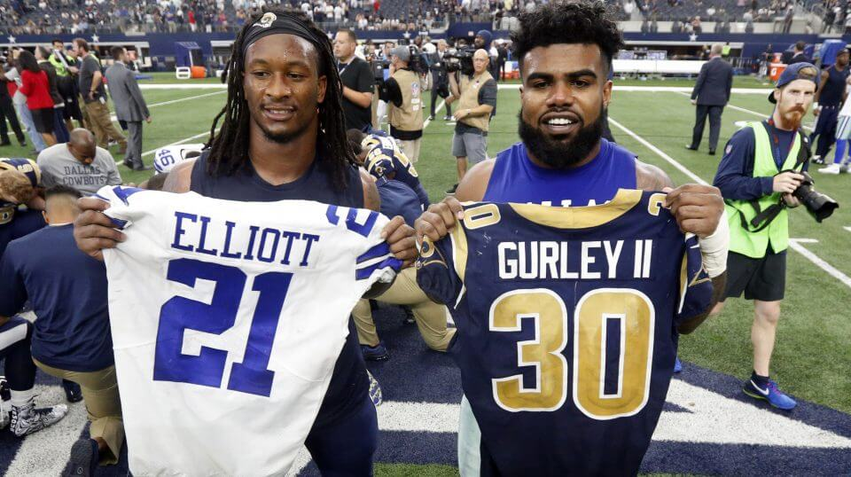 The Los Angeles Rams' Todd Gurley, left, and the Dallas Cowboys' Ezekiel Elliott, right, swap jerseys after an Oct. 1, 2017, game in Arlington, Texas.