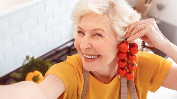 Grandma posing with tomatoes.