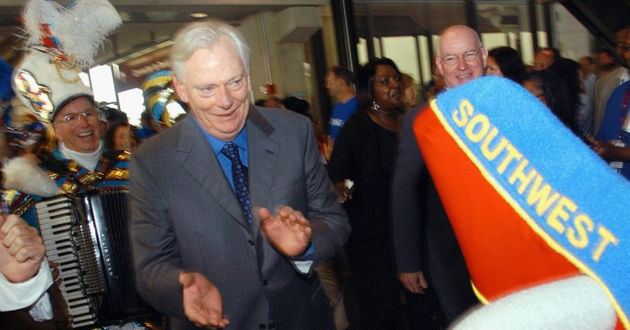 Southwest Airlines Chairman Herb Kelleher marches in a parade during a welcoming ceremony at Philadelphia International Airport.