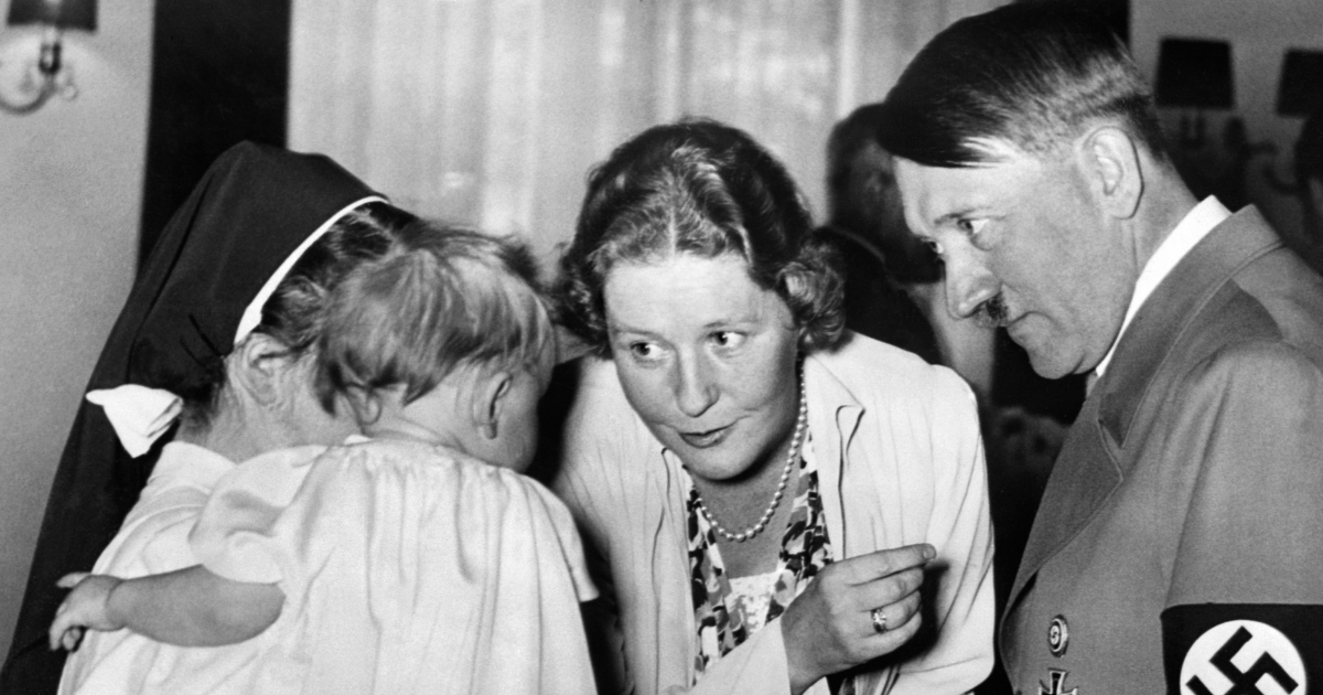 A picture dated 1939 shows German nazi Chancellor and dictator Adolf Hitler with Emmy Goering talking to a baby hold by a nun.