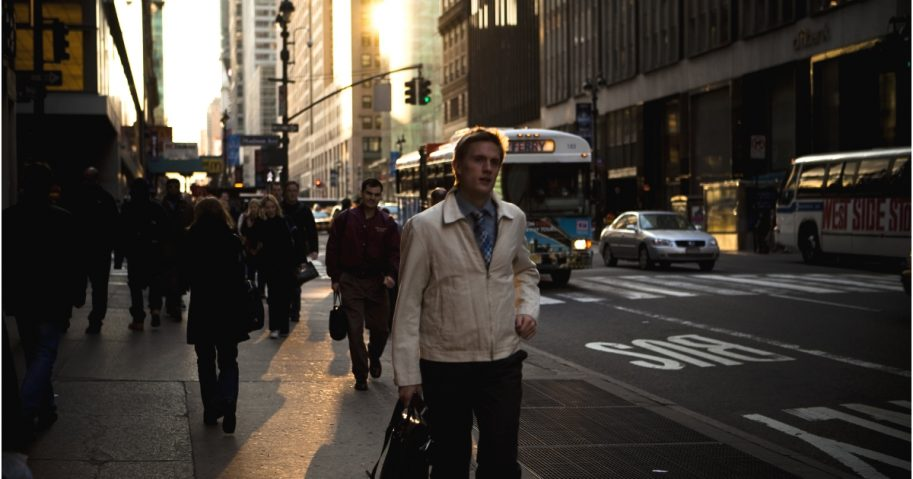 Pedestrians travel the streets during the late afternoon rush hour in Midtown Manhattan.