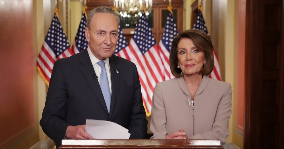 Speaker of the House Nancy Pelosi and Senate Minority Leader Charles Schumer pose for photographs after delivering a televised response to President Donald Trump's national address about border security.