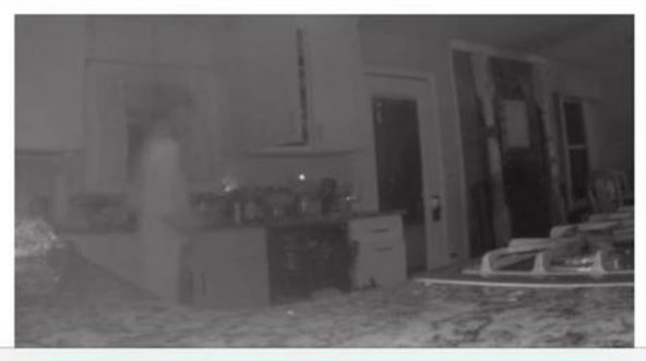 Security camera footage of a kitchen.