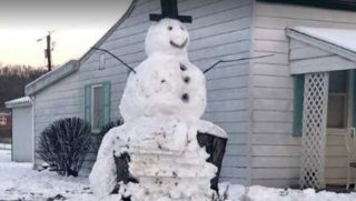 Snowman on stump