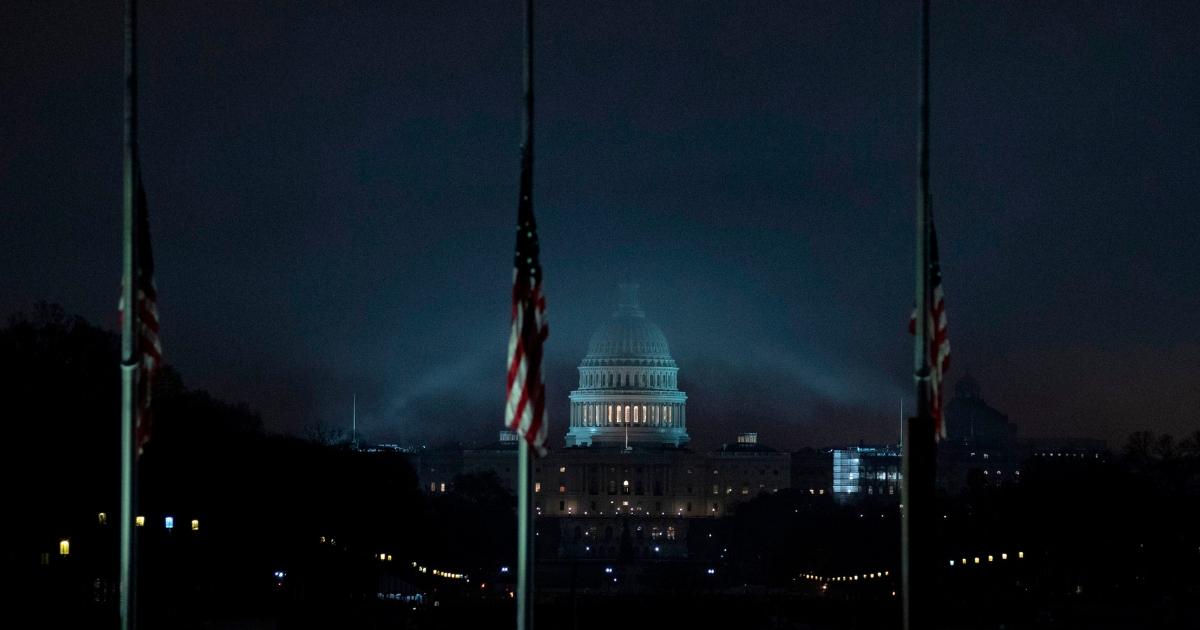 The US flag flies at half-staff in front of the Washington Monument and US Capitol.