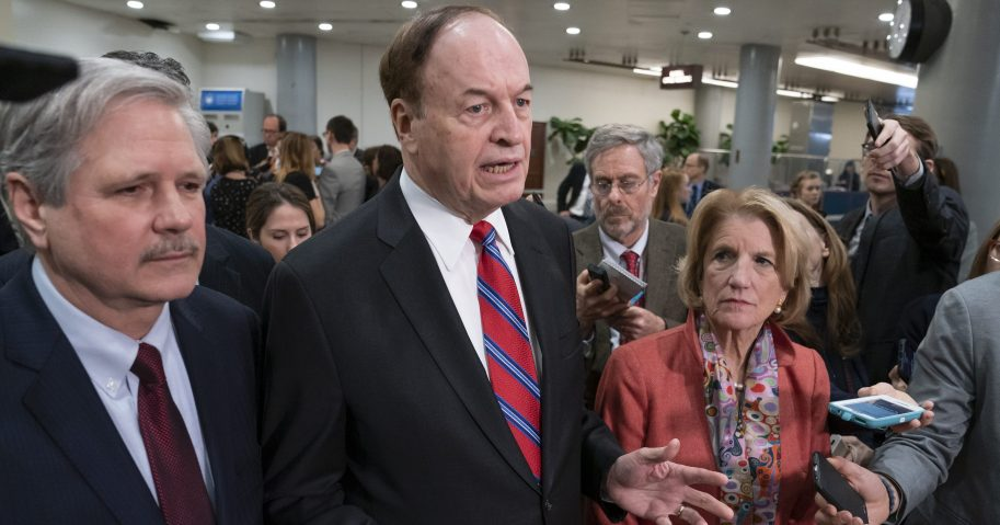 Sen. Richard Shelby, R-Ala., the top Republican on the bipartisan group working to craft a border security compromise in hope of avoiding another government shutdown, is joined by Sen. John Hoeven, R-N.D., left, and Sen. Shelley Moore Capito, R-W.Va., right, as they speak with reporters in Washington on Wednesday.