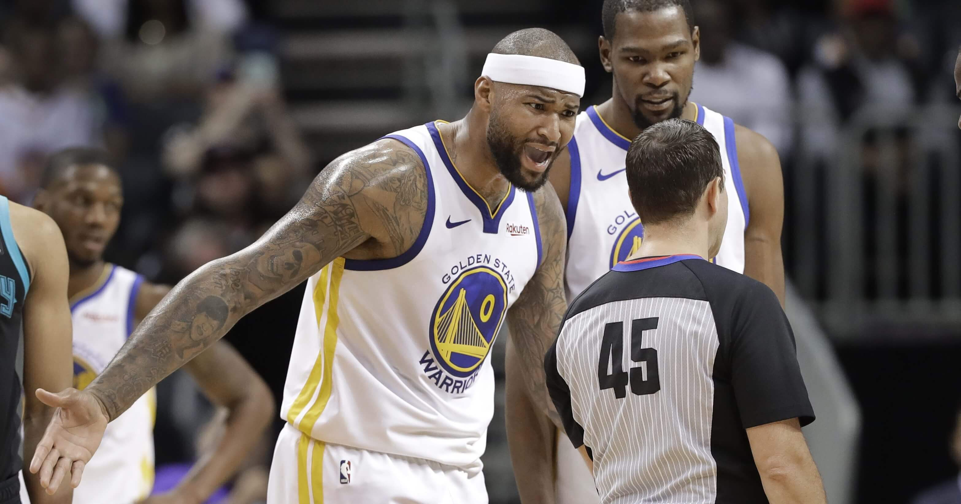 Golden State Warriors' DeMarcus Cousins reacts to being called for a technical foul by referee Brian Forte during the second half against the Charlotte Hornets in Charlotte, N.C., on Monday.
