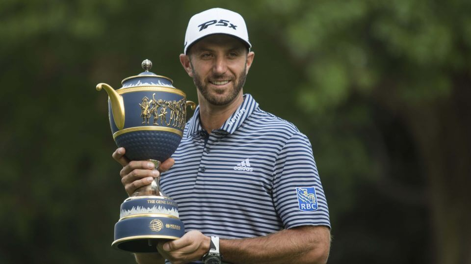 U.S. golfer Dustin Johnson poses with his Mexico Championship trophy at the Chapultepec Golf Club in Mexico City on Sunday.