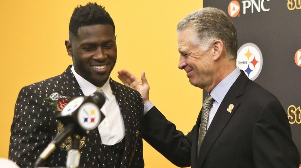 Pittsburgh Steelers wide receiver Antonio Brown, left, smiles as he is introduced by Steelers President Art Rooney II for a news conference about Brown's contract extension Feb. 28, 2017, in Pittsburgh