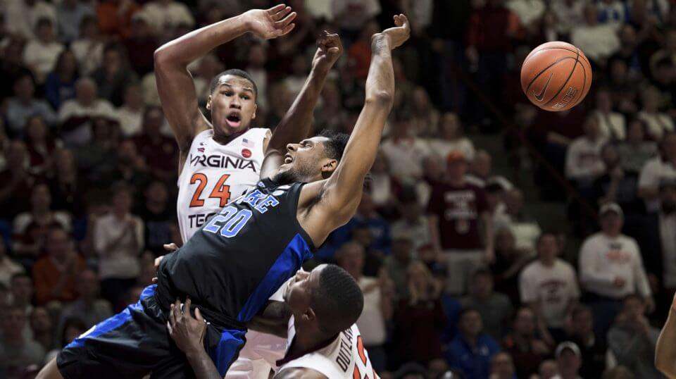 Duke center Marques Bolden is fouled as Virginia Tech's Kerry Blackshear Jr. (24) and Ty Outlaw (42) defend during Tuesday's game in Blacksburg, Virginia
