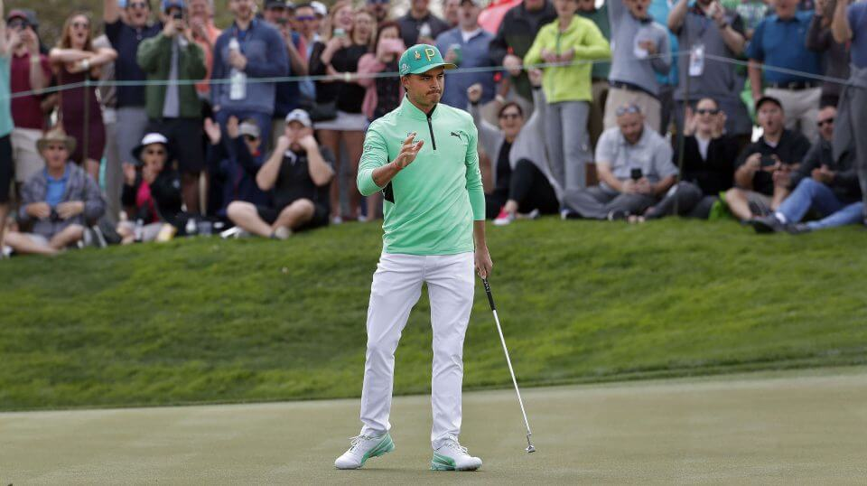 Rickie Fowler waves after making a birdie putt on the fifth green during the third round of the Phoenix Open PGA golf tournament on Saturday in Scottsdale, Arizona.