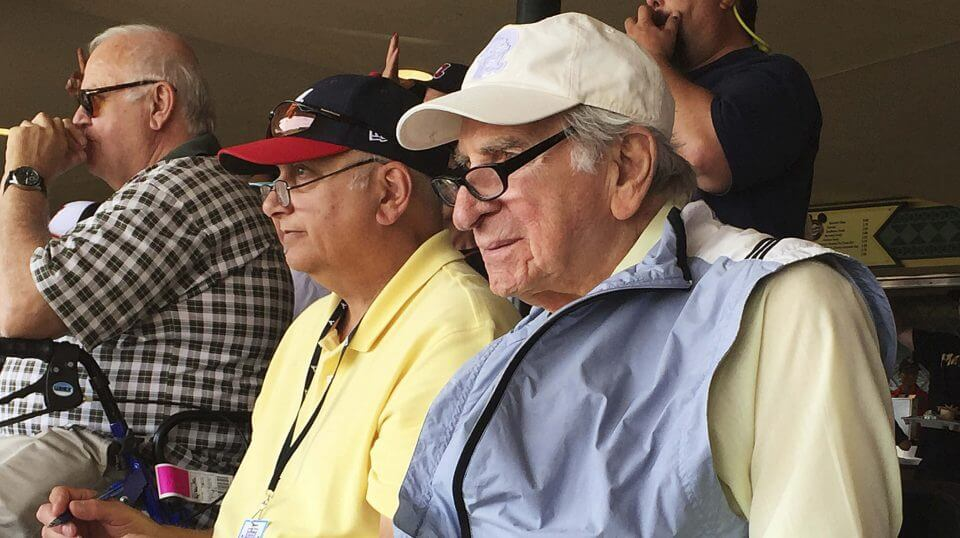 In this March 5, 2016, file photo, Tommy Giordano, right, special assistant to the general manager of the Atlanta Braves, scouts a spring training baseball game between the Braves and the Pittsburgh Pirates in Kissimmee, Florida.