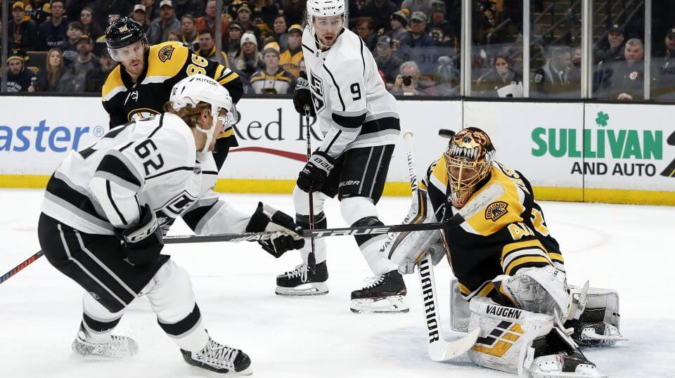 Boston Bruins goaltender Tuukka Rask takes a shot off his mask by the Los Angeles Kings' Carl Hagelin during a Feb. 9 game in Boston.