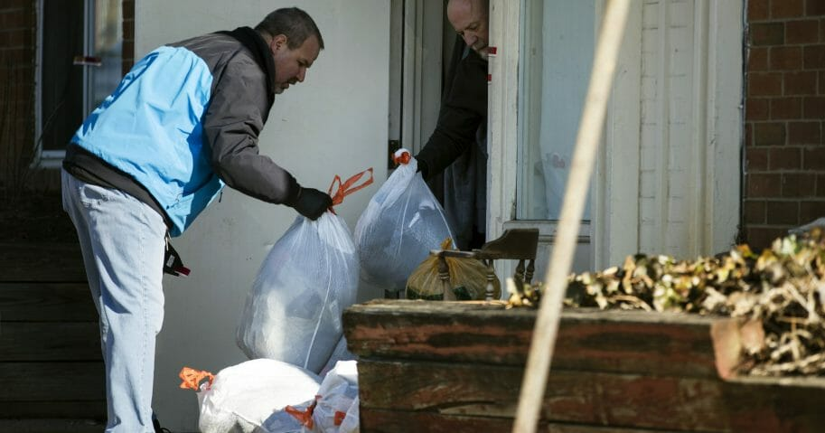 Investigators remove bags from a crime scene at the Robert Morris Apartments in Morrisville, Pennsylvania, on Feb. 26, 2019.