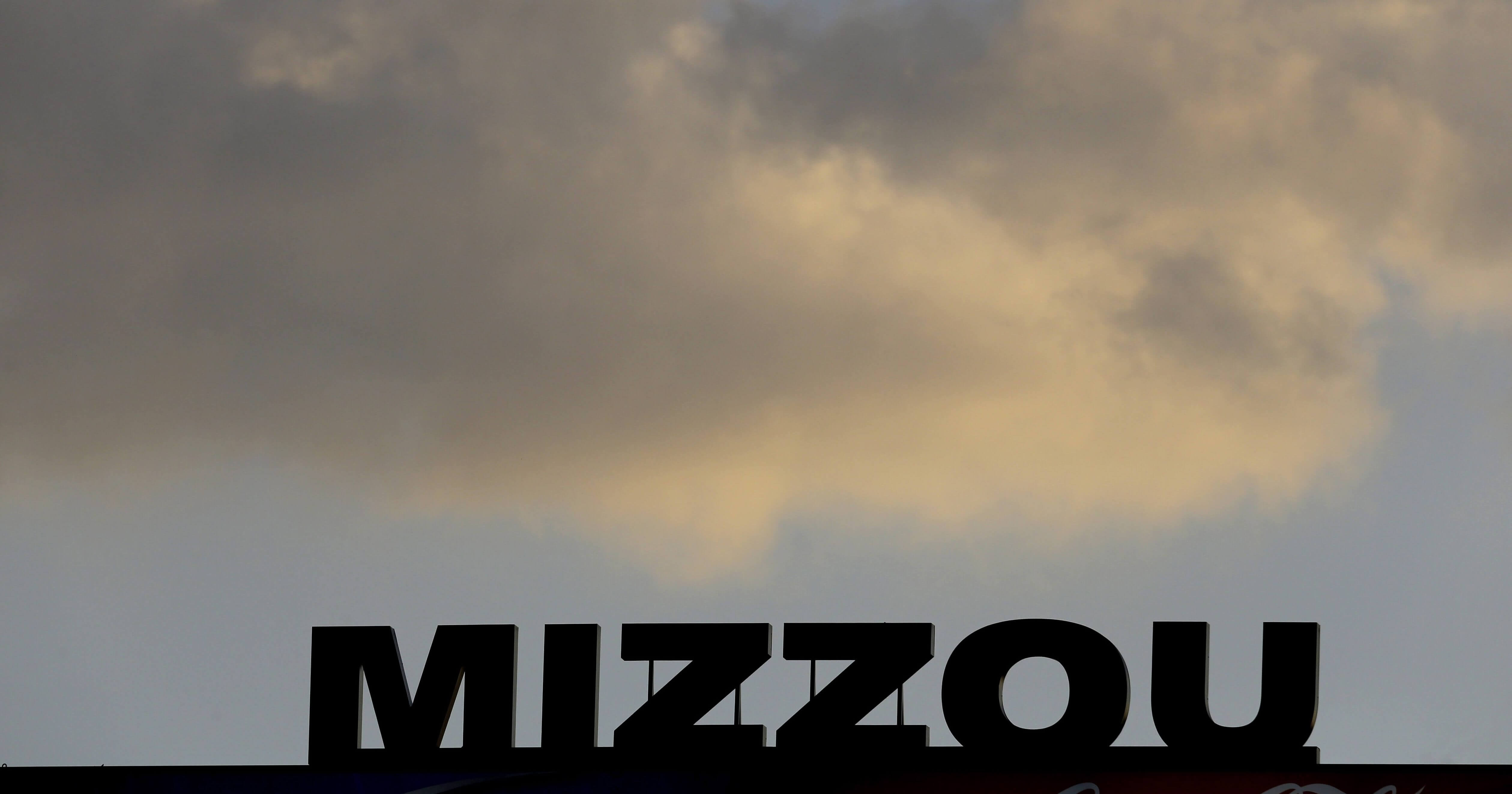 The Mizzou logo is seen on a scoreboard over Memorial Stadium at Faurot Field before the start of a Nov. 2, 2013, football game between Missouri and Tennessee in Columbia