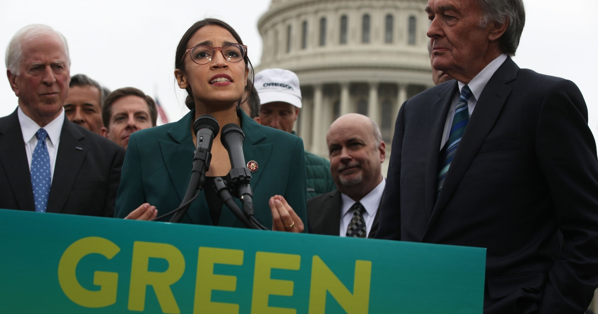 Rep. Alexandria Ocasio-Cortez (D-NY) speaks as Sen. Ed Markey (D-MA) (Right) and other Congressional Democrats listen during a news conference in front of the U.S. Capitol Feb. 7, 2019, in Washington, D.C.