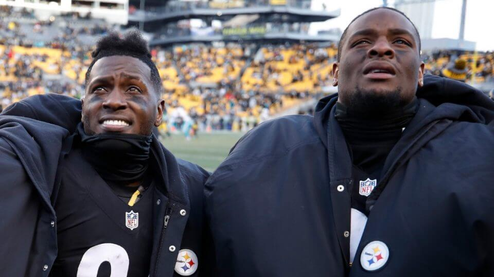 Antonio Brown, left, and Le'Veon Bell are seen on the sidelines during the Pittsburgh Steelers' Jan. 8, 2007 playoff game against the Miami Dolphins.