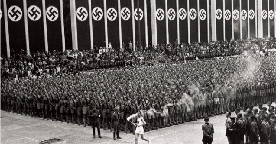 The Olympic torch is carried into the stadium during the opening ceremonies of the XI Olympic Games at the Olympic Stadium in Berlin, Germany, on Aug. 1, 1936.