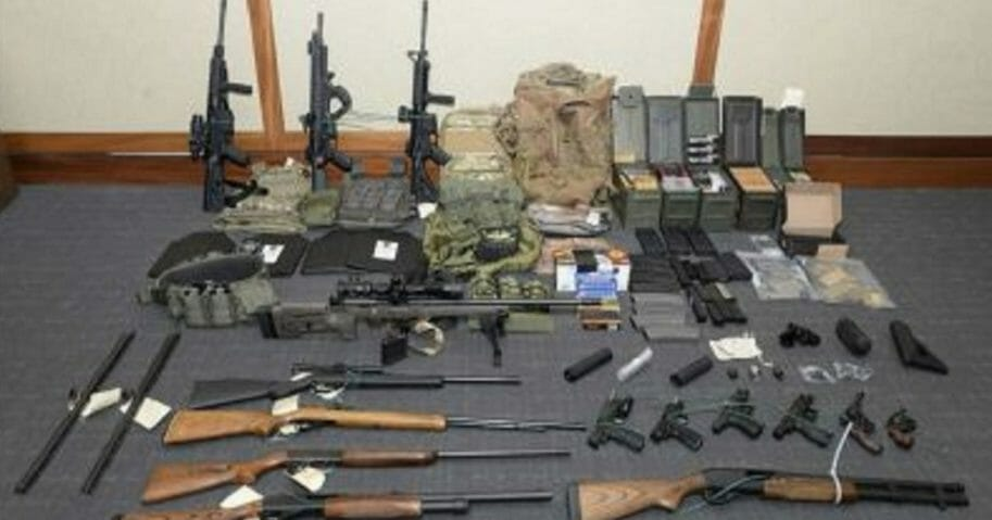 An image provided by the U.S. District Court in Maryland shows a photo of firearms and ammunition that was in the motion for detention pending trial in the case against Christopher Paul Hasson.
