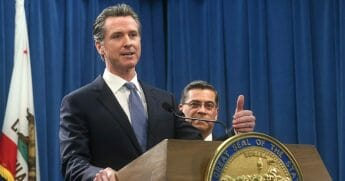 California Gov. Gavin Newsom answers a question concerning a lawsuit the state will likely file against President Donald Trump.