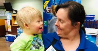 A little boy with Down syndrome and a woman with Down syndrome.