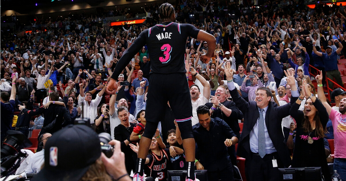Dwyane Wade of the Miami Heat celebrates after hitting a game-winning 3-pointer against the Golden State Warriors at American Airlines Arena on Wednesday.