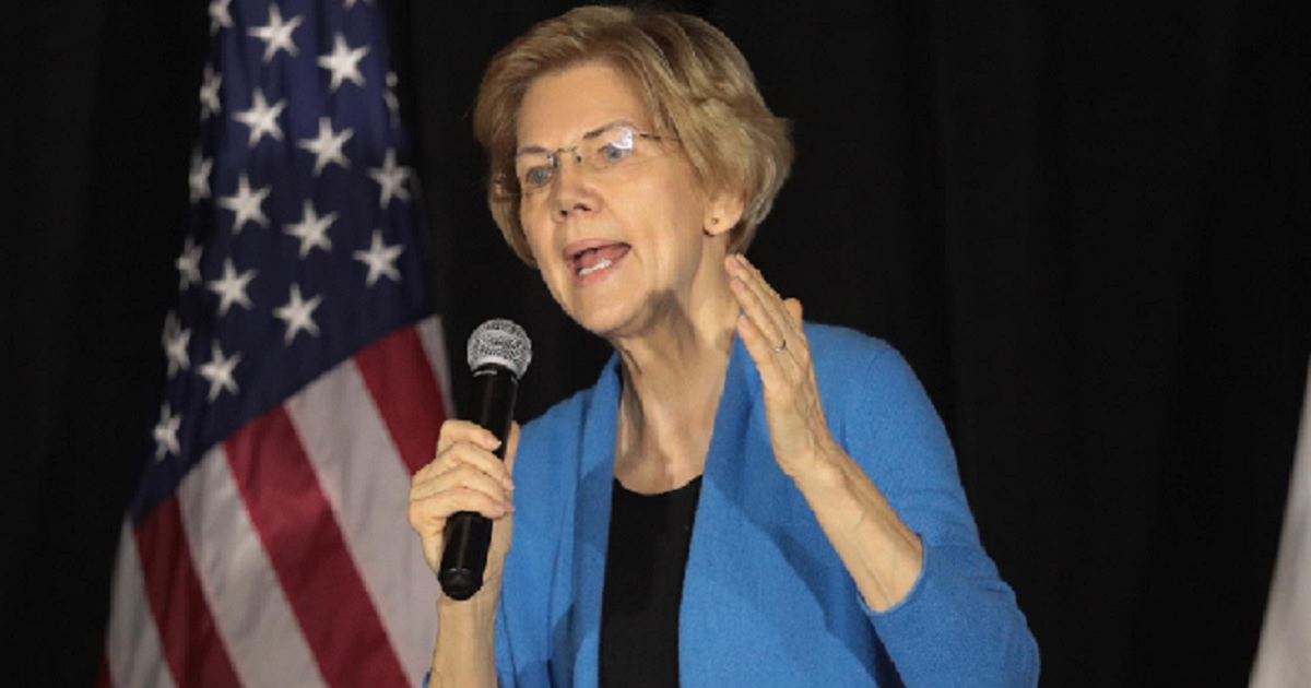 Warren Attacks Trump in Iowa, Suggests He May Be in Prison by 2020