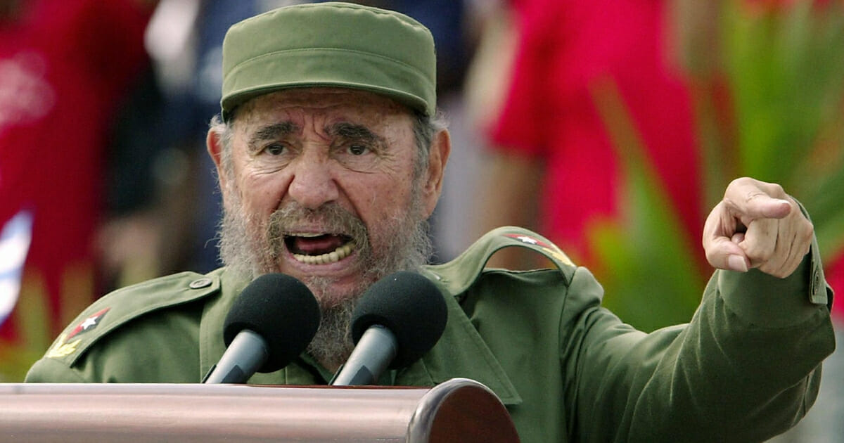 Then-Cuban President Fidel Castro presides over a massive May Day demonstration at Havana's Plaza de la Revolucion (Revolution Square) on May 1, 2005.