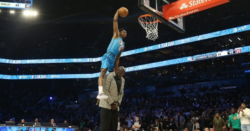Hamidou Diallo #6 of the Oklahoma City Thunder dunks over Shaquille O'Neal during the AT&T Slam Dunk as part of the 2019 NBA All-Star Weekend at Spectrum Center on February 16, 2019 in Charlotte, North Carolina