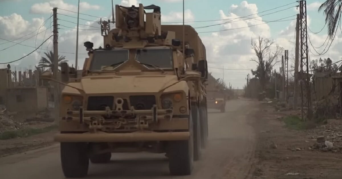 A Syrian Democratic Forces truck passes near the village of Baghouz, in eastern Syria, the final holdout of the Islamic State group in Syria.