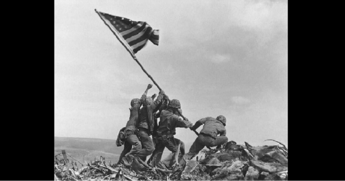 Photo of Marines raising the flag on Iwo Jima.