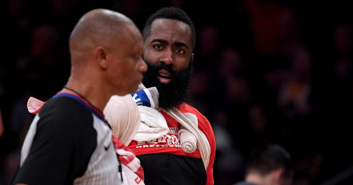 James Harden of the Houston Rockets argues with referee Michael Smith after getting three fouls during the first quarter in a 111-106 loss to the Los Angeles Lakers at Staples Center on Thursday in Los Angeles.