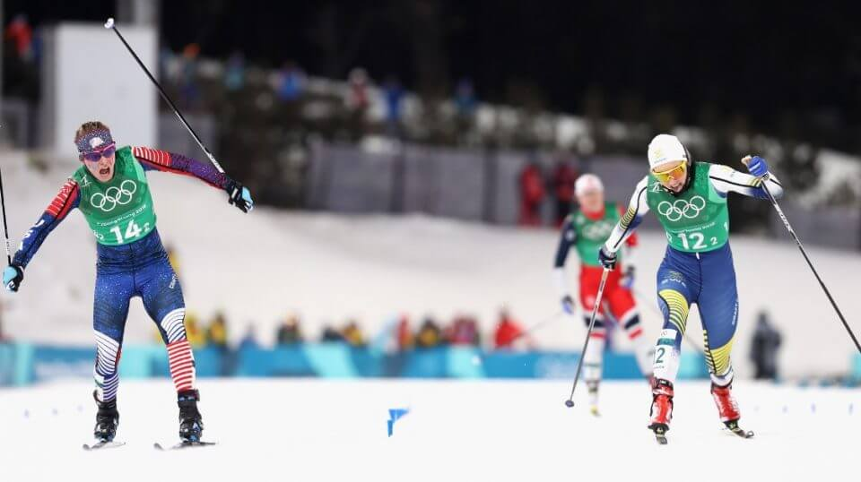 Jessica Diggins of the United States stretches across the finish line to win gold during the Cross Country Ladies' Team Sprint Free Final at the PyeongChang Winter Olympic Games on Feb. 21, 2018.