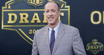 Jim Kelly, former QB of the Buffalo Bills arrives on the gold carpet for the first round of the 2015 NFL Draft at the Auditorium Theatre of Roosevelt University on April 30, 2015, in Chicago, Illinois.