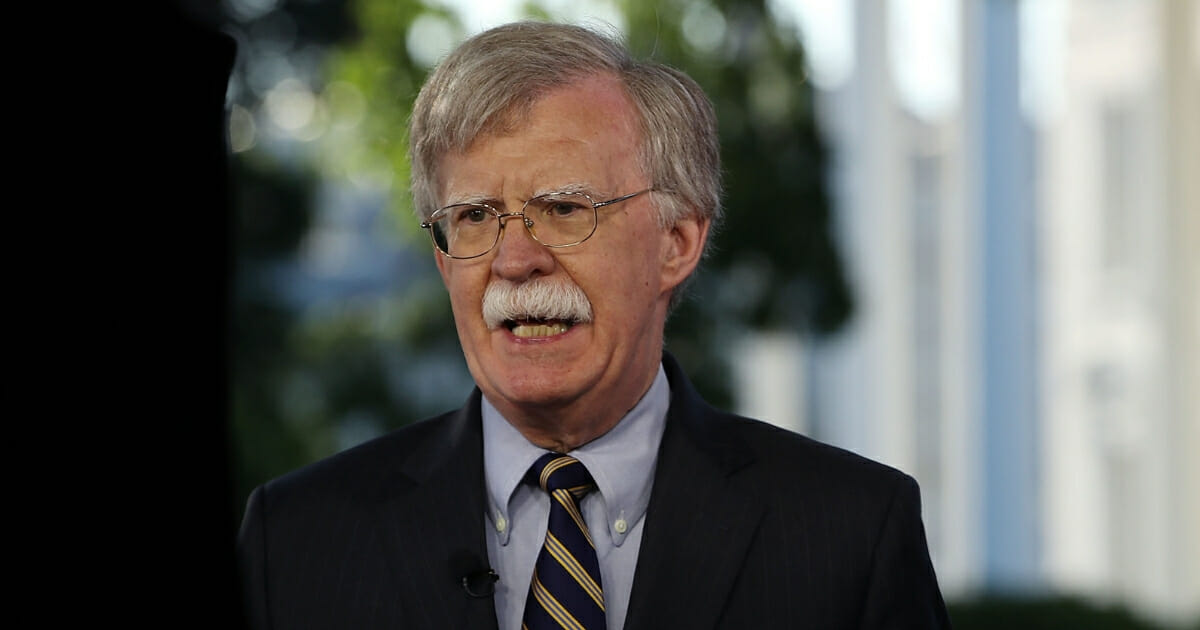 National Security Adviser John Bolton speaks on a morning television show from the grounds of the White House, on May 9, 2018.
