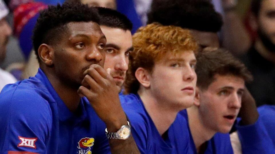 Kansas' Silvio De Sousa, left, watches from the bench during the first half of a Jan. 14 game against Texas in Lawrence.