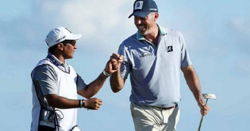 "Golfer Matt Kuchar and caddie David ""El Tucan"" Ortiz"