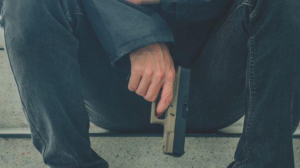 Man with Gun Sitting
