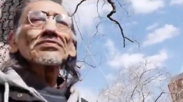 Native American activist Nathan Phillips is approached by a journalist for Breitbart News in Washington on Monday.