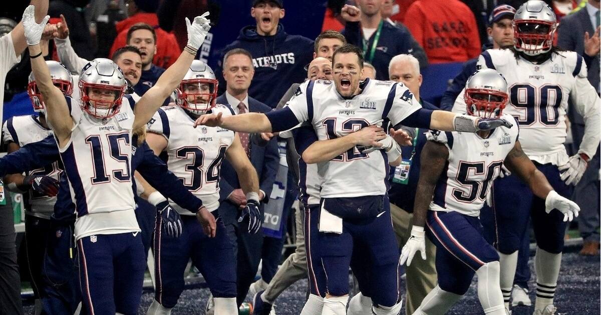 Quarterback Tom Brady (No. 12) and the rest of the New England Patriots celebrate after winning Super Bowl LIII against the Los Angeles Rams on Sunday at Mercedes-Benz Stadium in Atlanta.