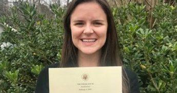 Rachel Robbins holding White House letter.