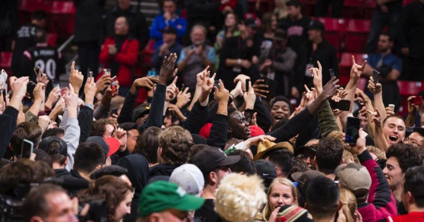 San Diego State students and fans rushed the court after the Aztecs upset No. 6 Nevada.