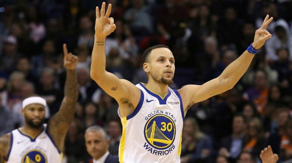 Golden State Warriors guard Stephen Curry celebrates his 3-pointer against the Phoenix Suns along with Warriors center DeMarcus Cousins on Friday.