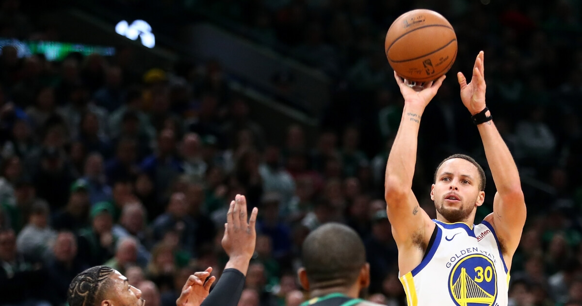 Stephen Curry of the Golden State Warriors takes a shot against the Boston Celtics at TD Garden on Jan. 26.