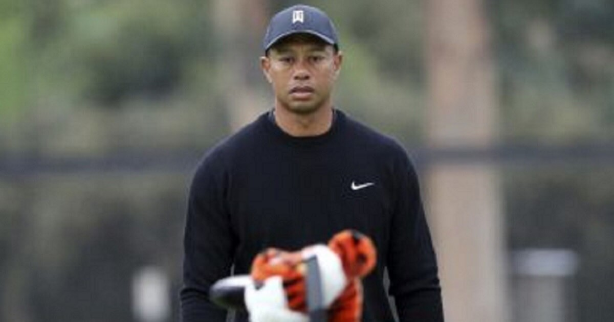 Tiger Woods walks the third green during the pro-am round at the Genesis Open golf tournament at Riviera Country Club in the Pacific Palisades area of Los Angeles on Wednesday.
