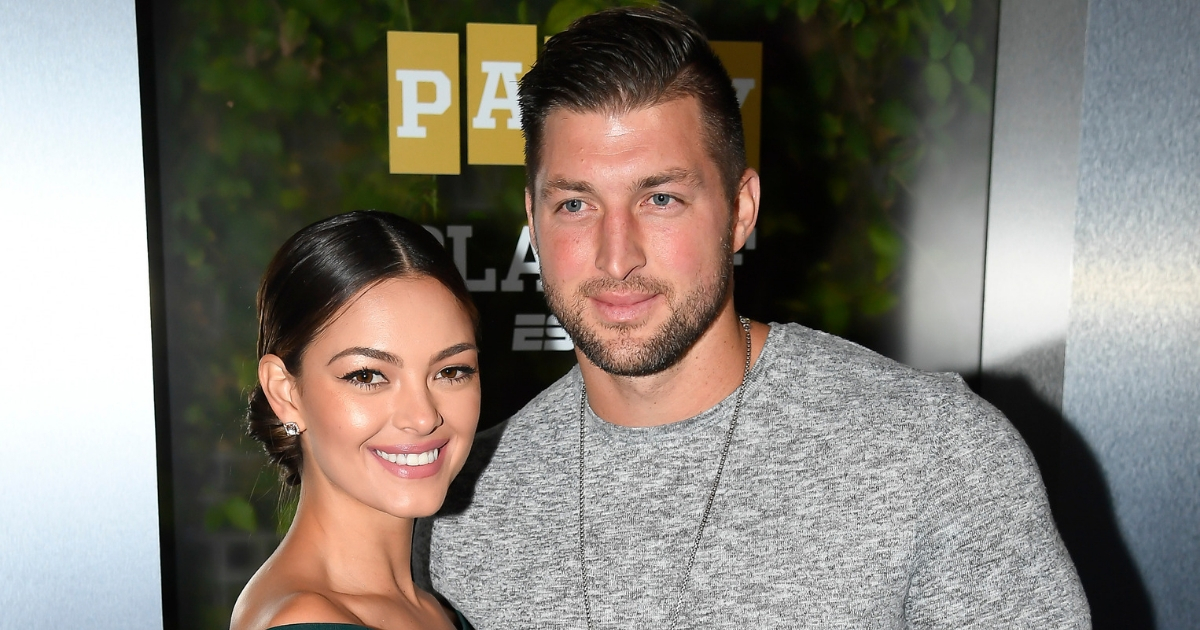 Miss Universe 2017 Demi-Leigh Nel-Peters and Tim Tebow of ESPN attend the Party At The Playoff at The GlassHouse on Jan. 5, 2019, in San Jose, California.