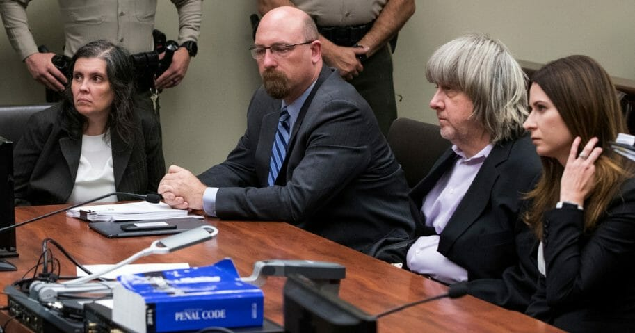 Louise Anna Turpin, left, and David Allen Turpin, second from right, appear in court with attorneys Jeff Moore and Alison Lowe on Jan. 18, 2018, in Riverside, California.