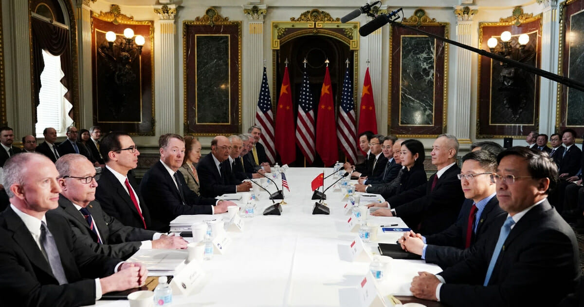 U.S. and Chinese representatives take part in trade talks Thursday in the Eisenhower Executive Office Building, next to the White House.