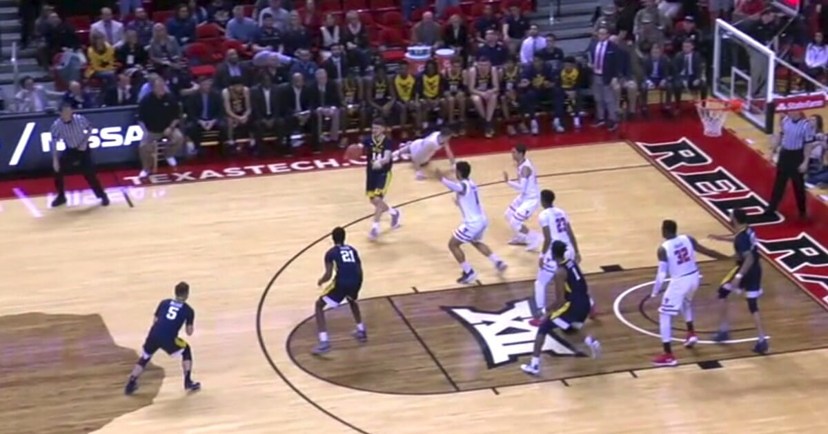 Texas Tech guard Matt Mooney wandered into the West Virgina bench area early in the second half and Logan Routt, who was riding the pine, sent him to the floor with a sneaky trip.